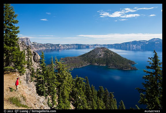 Visitor looking, Wizard Island and lake. Crater Lake National Park (color)