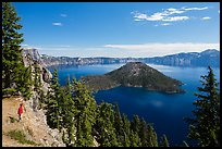 Visitor looking, Wizard Island and lake. Crater Lake National Park, Oregon, USA.