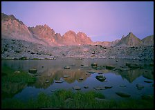 Mt Agasiz, Mt Thunderbolt, and Isoceles Peak reflected in a lake in Dusy Basin, sunset. Kings Canyon National Park, California, USA. (color)