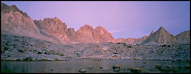 Pink light on High Sierra and lake at twilight. Kings Canyon National Park (Panoramic color)