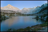 Columbine Peak, Palissades, and Mt Giraud at dusk above lake. Kings Canyon National Park, California, USA.
