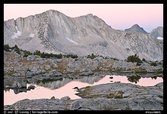 Mountains reflected in calm alpine lake at dawn, Dusy Basin. Kings Canyon National Park (color)