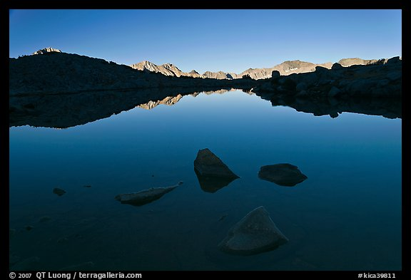 Rocks and calm lake with reflections, early morning, Dusy Basin. Kings Canyon National Park (color)