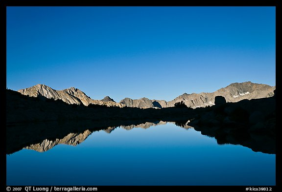 Mountain range reflected in calm lake, Dusy Basin. Kings Canyon National Park (color)