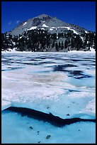 Ice break up in lake Helen and Lassen Peak, early summer. Lassen Volcanic National Park, California, USA.