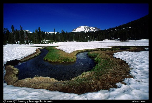 Stream in partly snow-covered Kings Creek meadows, morning. Lassen Volcanic National Park, California, USA.