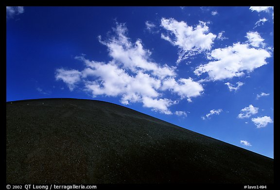 Smooth cinder cone profile and clouds. Lassen Volcanic National Park (color)