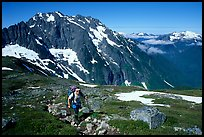 Mountaineer hiking on the way to Sahale Peak,  North Cascades National Park. Washington, USA. (color)