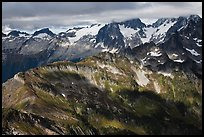 Cloud-capped mountains in dabbled light, North Cascades National Park.  ( color)