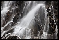 Water falling over volcanic rock, North Cascades National Park. Washington, USA.