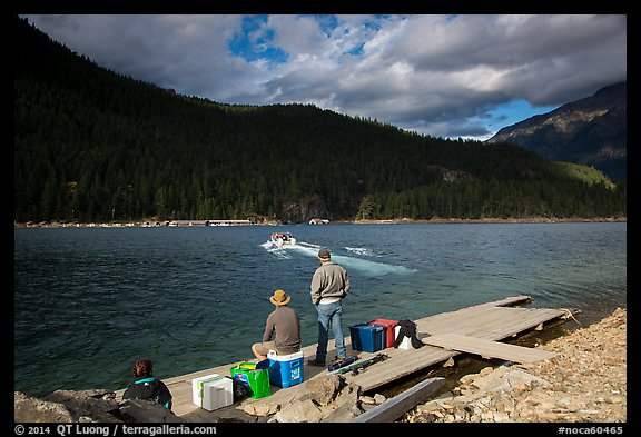 Guests waiting for ride across lake to Ross Lake resort, North Cascades National Park Service Complex.  (color)
