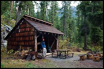 Hiker at high Bridge campground shelter, North Cascades National Park.  ( color)