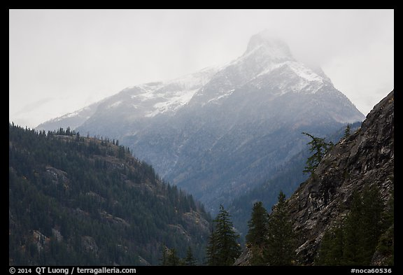 Snow-capped jagged peak in clouds, North Cascades National Park.  (color)