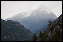 Snow-capped jagged peak in clouds, North Cascades National Park. Washington, USA.