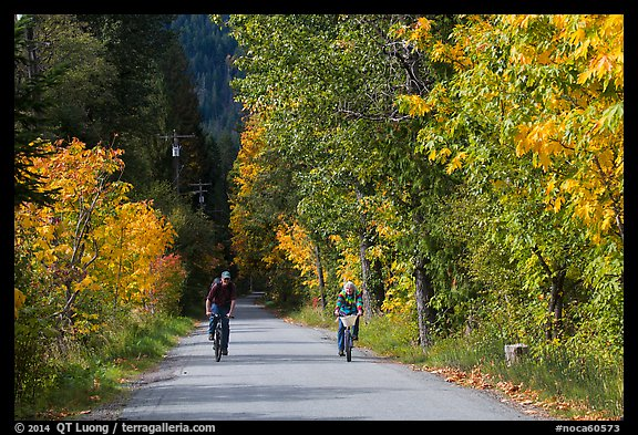 Bicyclists in autumn, Stehekin, North Cascades National Park Service Complex.  (color)