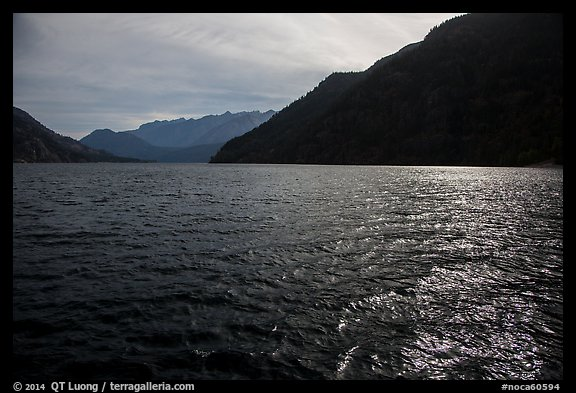 Sun shimmering in Lake Chelan waters, North Cascades National Park Service Complex.  (color)