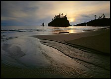 Stream, beach, and sea stacks at sunset, Second Beach. Olympic National Park, Washington, USA.