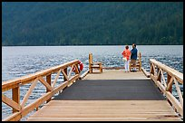 Couple on Pier, Crescent Lake. Olympic National Park, Washington, USA. (color)