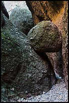 Boulder wedged in slot, Balconies Caves. Pinnacles National Park, California, USA.
