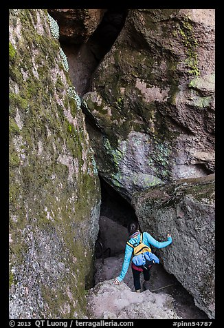 Woman walking into Balconies Cave. Pinnacles National Park (color)