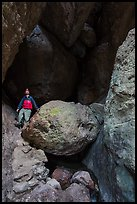 Man with headlamp looking up in Balconies Cave. Pinnacles National Park ( color)