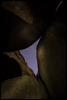Night sky seen through opening between boulders. Pinnacles National Park, California, USA.