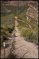 Boundary fence on steep hillside. Pinnacles National Park, California, USA. (color)