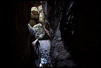 Hiker with lamp in Bear Gulch Cave. Pinnacles National Park ( color)