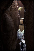 Hiker in narrow and deep section of Lower Bear Gulch Cave. Pinnacles National Park ( color)