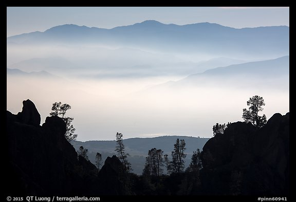Silhouetted pinnacles and trees, mountains and valley fog. Pinnacles National Park (color)