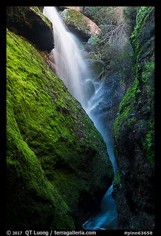 Waterfall spilling down from reservoir into Bear Gulch Cave. Pinnacles National Park (color)