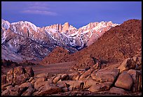 Volcanic boulders in Alabama hills and Mt Whitney, dawn. Sequoia National Park, California, USA.