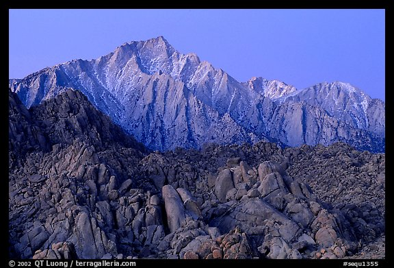 Volcanic boulders in Alabama hills and Lone Pine Peak, dawn. Sequoia National Park, California, USA.