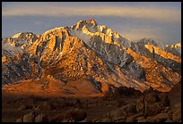 Volcanic boulders in Alabama hills and Lone Pine Peak, sunrise. Sequoia National Park, California, USA.