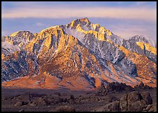 Volcanic boulders in Alabama hills and Lone Pine Peak, sunrise. Sequoia National Park, California, USA. (color)