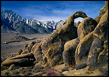 Rock arch and Sierra Nevada range with Mt Whitney, morning. Sequoia National Park, California, USA.