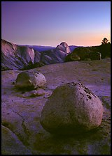 Glacial erratic boulders and Half Dome, Olmsted Point, dusk. Yosemite National Park, California, USA.