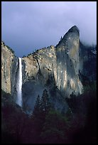 Bridalveil Falls and Leaning Tower, stormy sky. Yosemite National Park, California, USA.