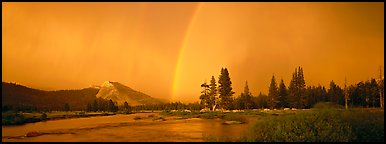 Evening storm with rainbow over Tuolumne Meadows. Yosemite National Park (Panoramic color)