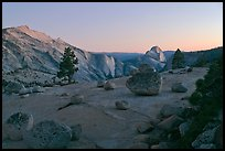 Glacial erratic boulders, Clouds Rest, and Half-Dome from Olmstedt Point, dusk. Yosemite National Park, California, USA.
