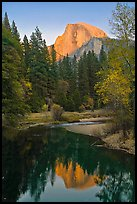 Half Dome reflected in Merced River at sunset. Yosemite National Park, California, USA. (color)