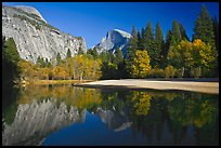 North Dome and Half Dome reflected in Merced River. Yosemite National Park, California, USA.