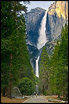 Tourists on path dwarfed by Upper and Lower Yosemite Falls. Yosemite National Park, California, USA.
