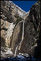 Lower Yosemite Falls and rock wall with snowy trees on rim. Yosemite National Park ( color)