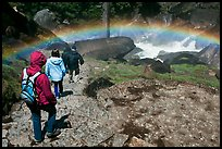 Hikers walking through rainbow, Mist Trail. Yosemite National Park ( color)