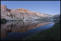 Fletcher Peak reflected in Vogelsang Lake, dusk. Yosemite National Park ( color)