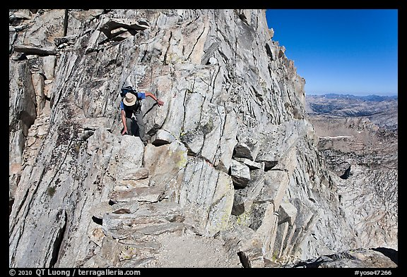 Hiker on summit block of Mount Conness. Yosemite National Park (color)
