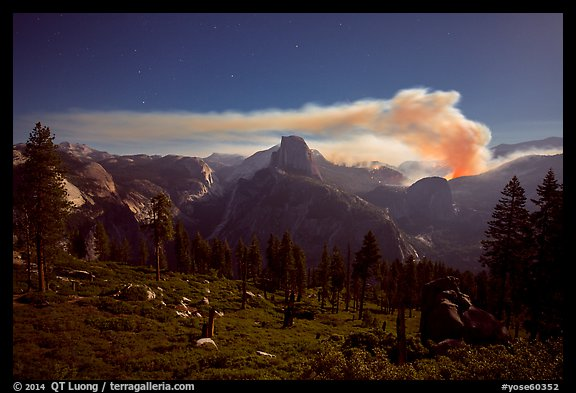Half-Dome and plume of smoke from forest fire at night. Yosemite National Park (color)