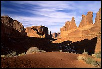 South park avenue, an open canyon flanked by sandstone skycrapers. Arches National Park, Utah, USA.