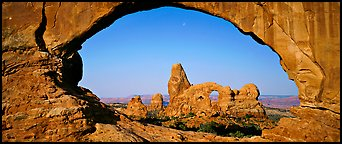 Turret Arch through slickrock window. Arches National Park (Panoramic color)